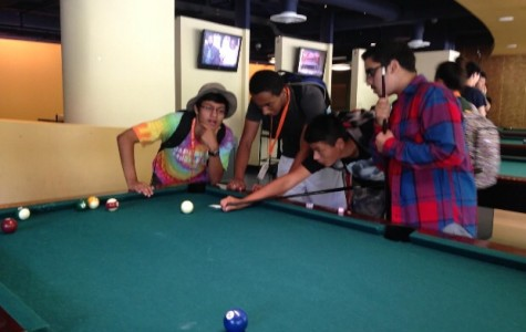 Junior Jeffery Montano takes some time away from the books and shoots pool during his lunch break with his friends.