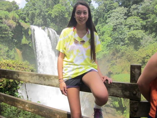 Adenan+posing+in+front+of+a+waterfall+she+found+in+the+woods.