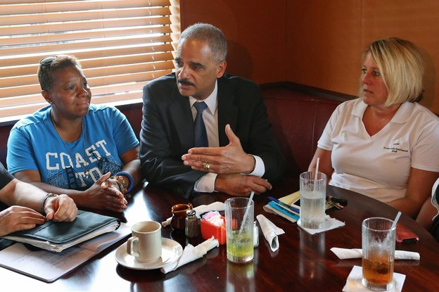Attorney General Eric Holder listens to citizens' remarks on the ongoing unrest in Ferguson, Missouri