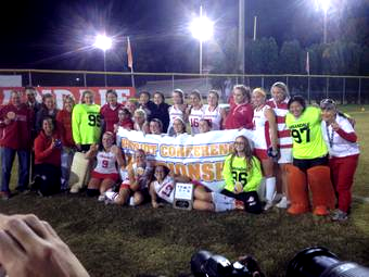 The AHS varsity field hockey team poses after winning the conference title game against South County.