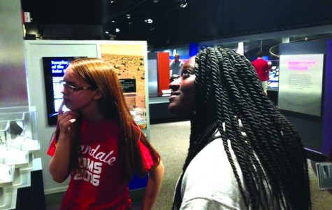 Students in Group 4 examine an exhibit at the museum.