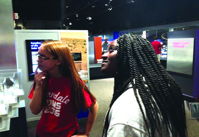 Students+in+Group+4+examine+an+exhibit+at+the+museum.
