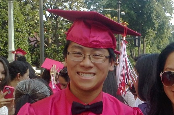 Photo of Wilson Tu taken at his graduation.