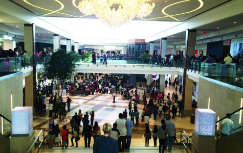 Many people have arrived at the town center and look forward to the new and improved stores and restaurants. Shoppers rush to the opening of Topshop.