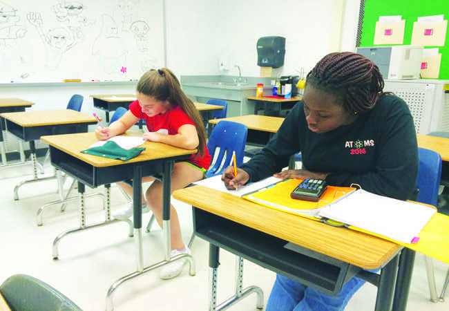 students work on homework and get help from teachers after school