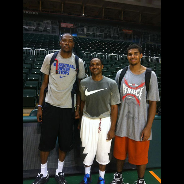Zormelo (middle) poses with Kevin Durant (left), one of the players that he trains.