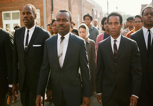 Oyelowo (second from left) as King, pictured leading the second march to the Edmund Pettus Bridge.