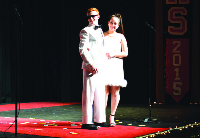 Lamb and his escort, senior Kaytlin Hopkins, during the Elegance portion of the competition.