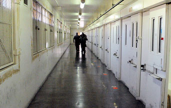 Workers walk through the halls where executions take place.