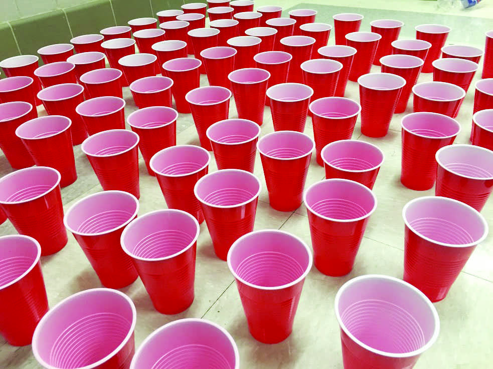 A common senior prank is  blocking hallways with water-filled cups.