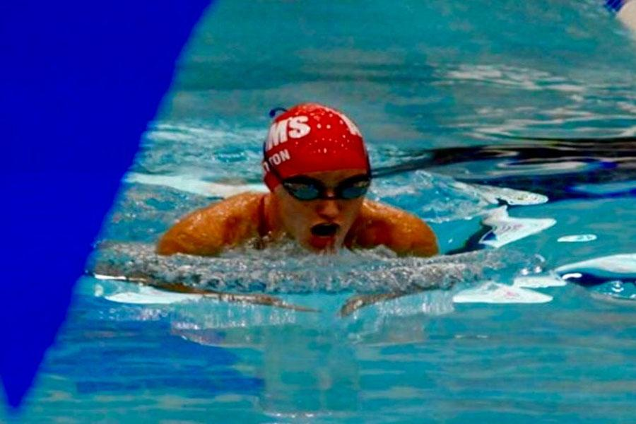 Swimmer Ashley Britton comes up to take a breath while preforming the 100 meter breaststroke.