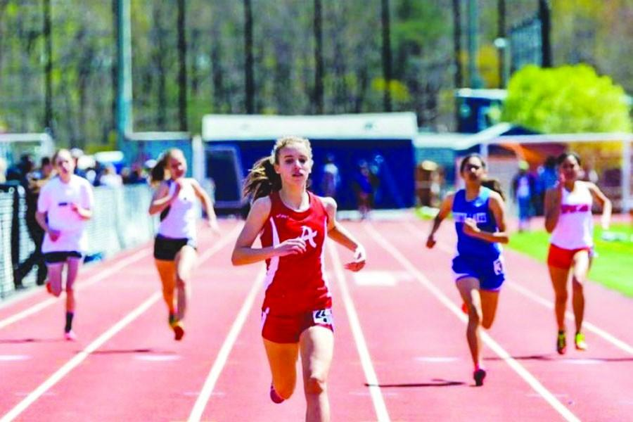 Junior Kelsie Licatovich sprints to the finish line in the 200 meter dash at an invitational meet last year.