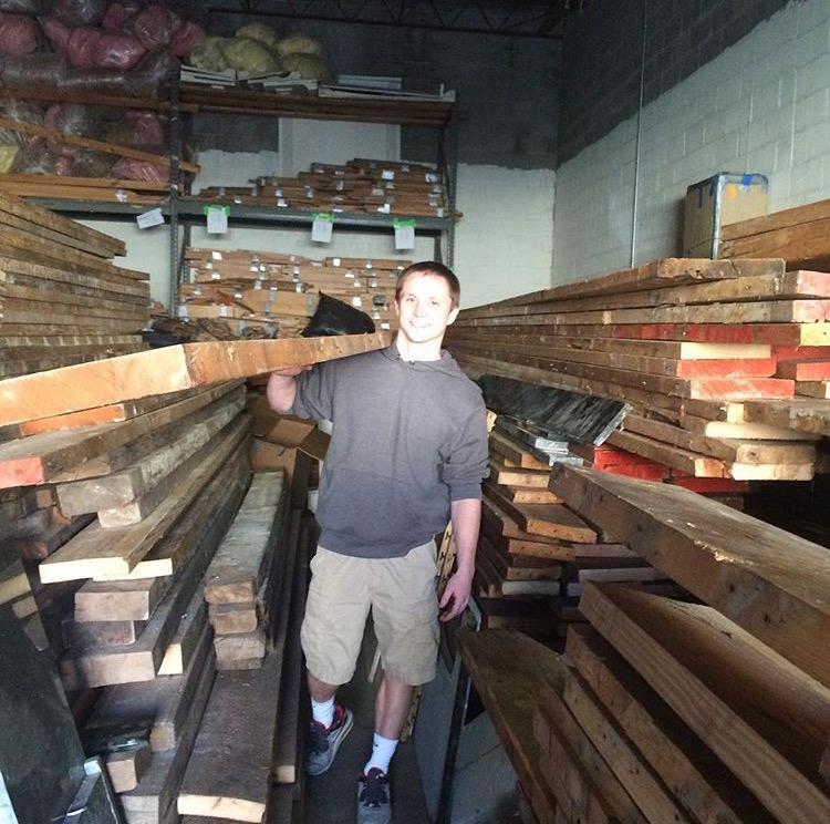 Senior+Brandon+Hughes+helping+out+at+the+Rebuild+Warehouse