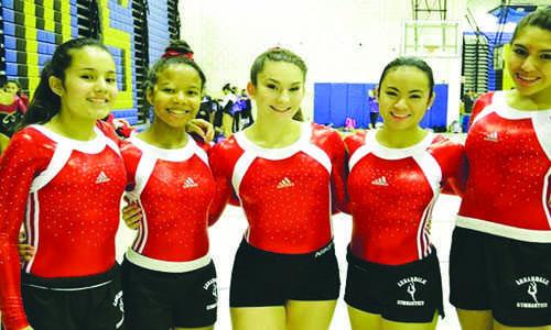 Gymnastics poses for a team photo, (left to right), Luisa Pedraza, Alichia House, Mollie Valorose, Ivana Jarin, Nicolle Uria