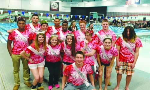 Seniors pose for senior swim picture against Woodson for their last meet of the season.
