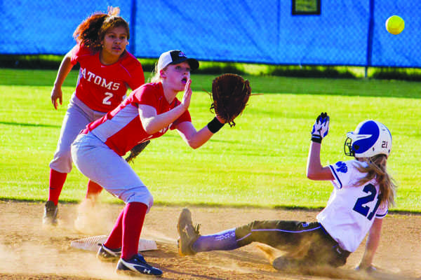 Sophomore Elizabeth Corcoran stradles the bag to get the out against West Potomac last year.