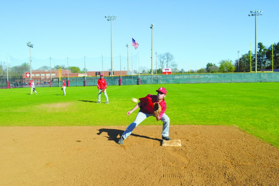 Junior utility player Ricky Sobalvarro catches the ball from the catcher playing shortstop.