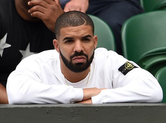 Drake watching a match at Wimbledon.