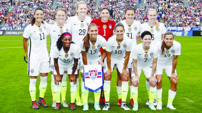 The U.S. women's national team poses for a picture.