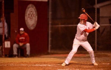 Junior Liam Conroy batting during a game.