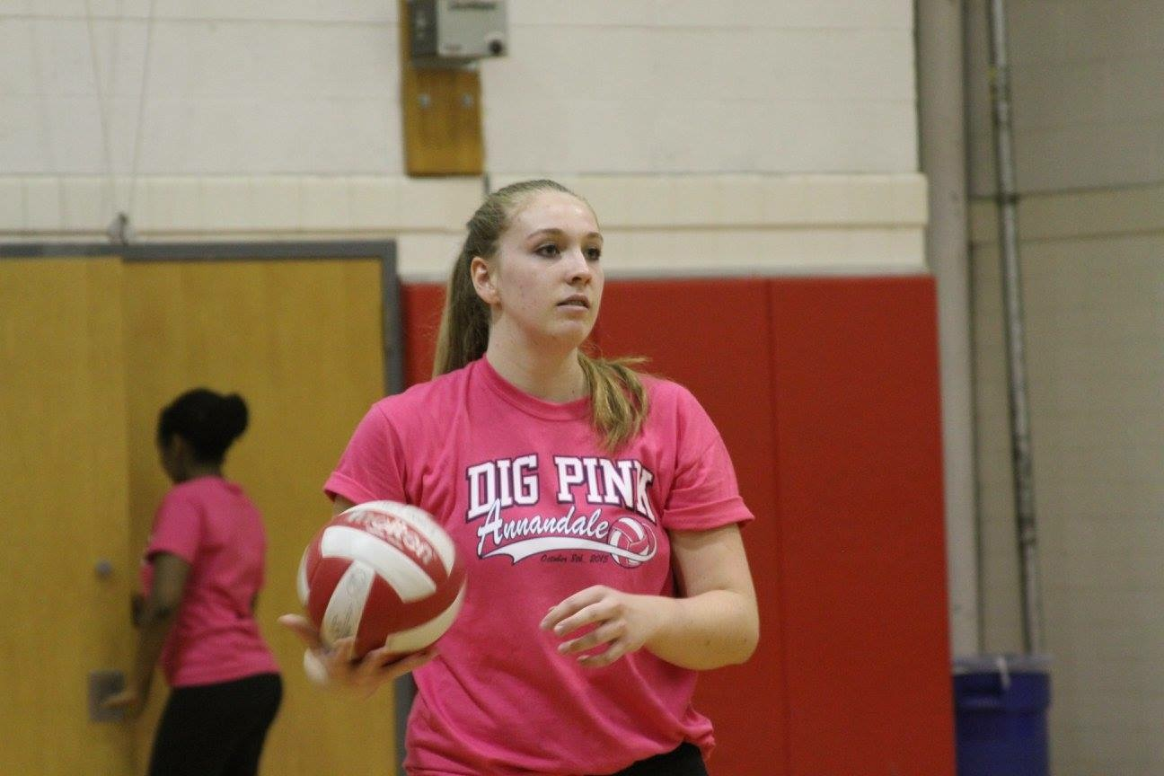 Katie Garish spins the ball on her hand during warm ups of a match