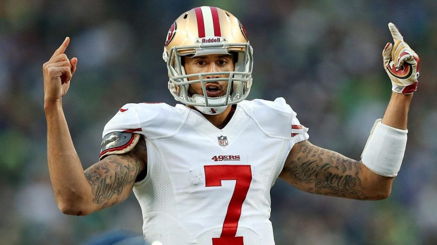 Kaepernick under fire for sitting during anthem.