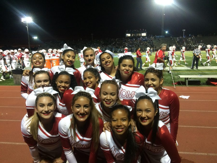 The cheer team poses for a picture during the football game against Centreville High School