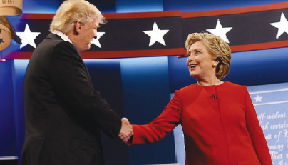 Hillary Clinton and Donald Trump shake hands before their debate at Hosftra University in New York.