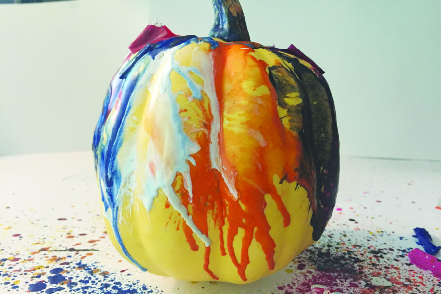 Turn+your+blow+dryer+on+hot%2C+and+blow+dry+the+crayons+on+the+pumpkin+until+they+melt.