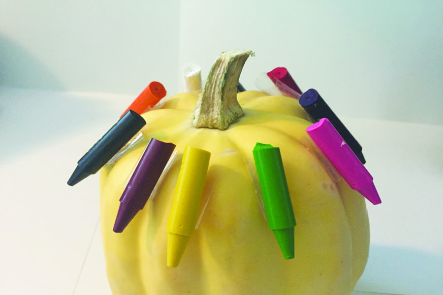 Tape+the+crayons+on+the+pumpkin%2C+and+keep+them+a+little+spread+out.+