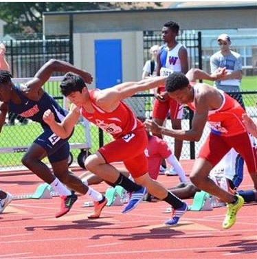 Senior Jacob Weber gets out of the starting blocks in the 100-meter hurdles event.