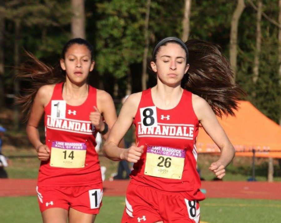 Sophomore+Vitalina+Fuentes+%28left%29+and+Junior+Janice+Milian+%28right%29+compete+in+the+mile.