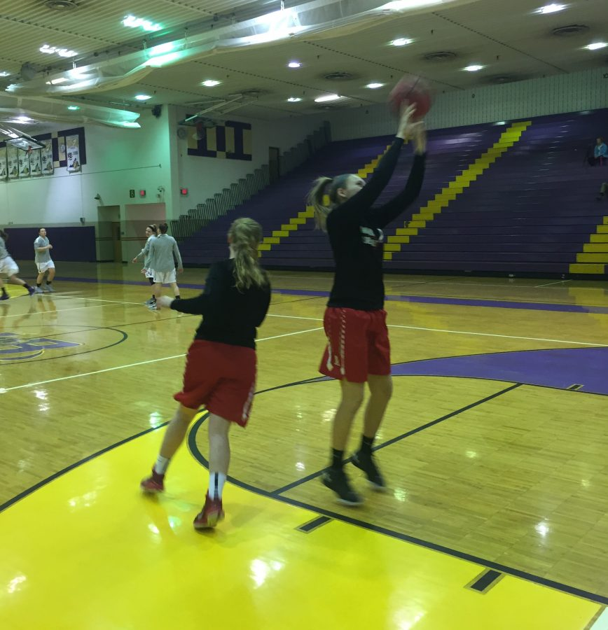 Junior Grace Hatch takes a warm-up jump shot for a game against Lake Braddock on Jan. 10.