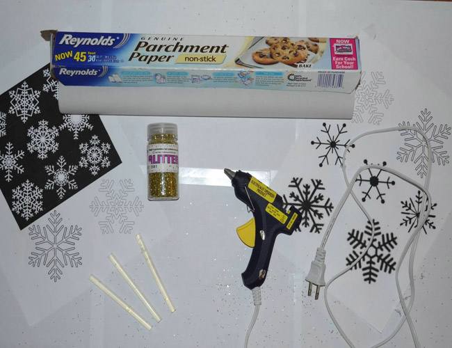 Materials+Needed%3A+Print+snowflakes+patterns%2C+Parchment+paper%2C+Hot+glue+gun%2C+Glue+gun+sticks%2C+Glitter+