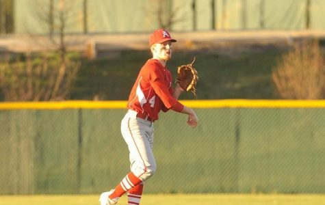 Senior Liam Conroy practices throwing before a game.