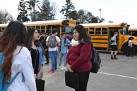 Sophomore+Jessica+Ambrocio+talks+with+friends+after+school+before+they+go+on+the+bus.+%22The+bus+is+very+loud%2C+but+I+have+no+other+way+home+so+I+take+the+bus%2C%22+Ambrocio+said.