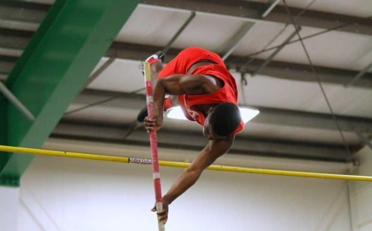 Senior+Jeremiah+Bethea+breaks+the+AHS+school+record+for+the+pole+vault+event+at+the+state+meet+on+Feb.+25.+
