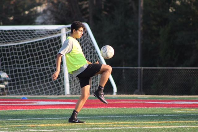 Junior, Rudy Flores juggles the ball in the goalie box before practice.