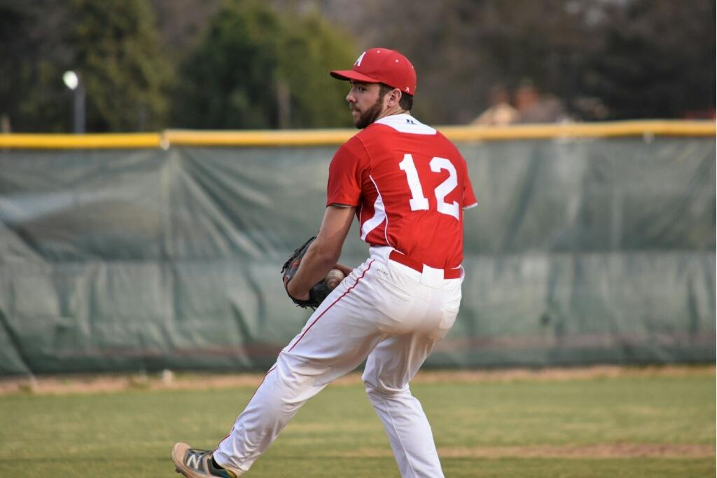 Sophomore Alex Brennan pitches during a game.