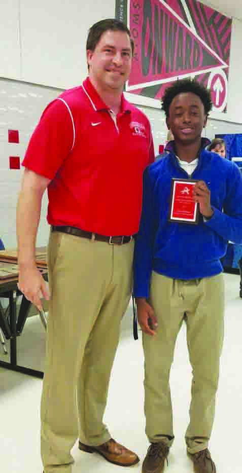 Award winner Dazon Harris  poses with Coach Behne