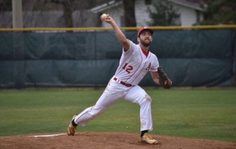 Sophomore Alex Brennan pitches during the game against the Lee Lancers on April 1.