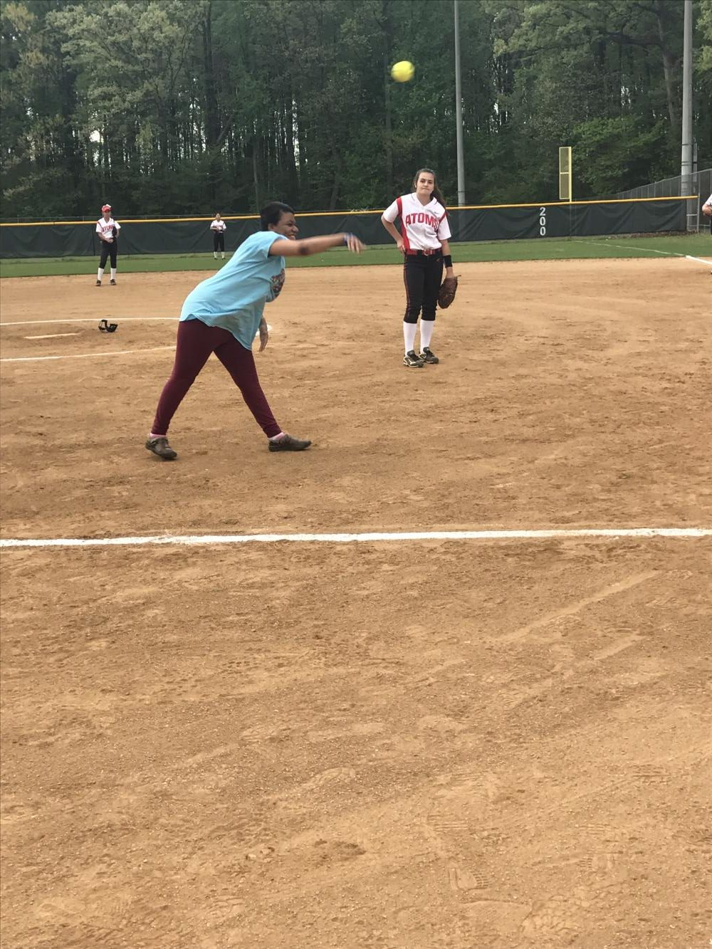 Senior Brooke Mahoney throws out the opening pitch in the game against the Spartans on April 21.