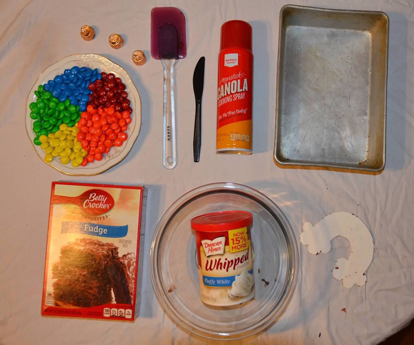 Place+a+few+rolos+at+the+end+of+the+rainbow+as+the+pot+of+gold+and+enjoy.%0A+-Pan+of+brownies%0A+-Frosting%0A+-Bowl%0A+-Whisk%0A+-Spatula%0A+-Rolos%0A+-M%26Ms%0A+-Eggs%0A+-Water%0A+-Canola+oil%0A+-Baking+pan%0A+-Rainbow+Template%0A+-Plastic+knife