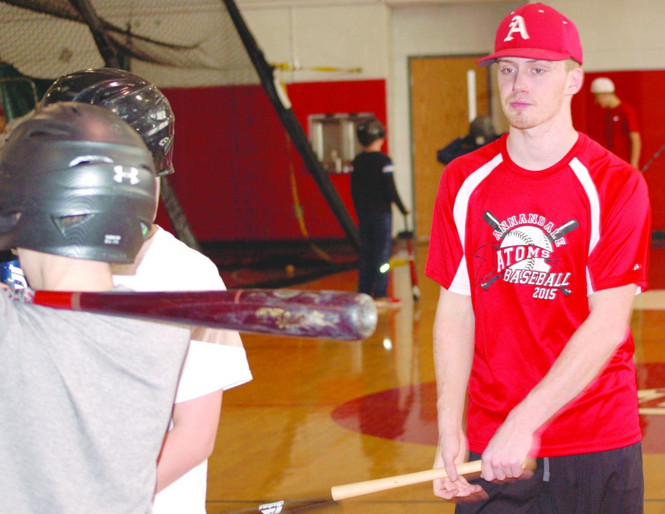 Senior Liam Conroy working with future student-athletes at a session of the winter baseball camp on January 22.