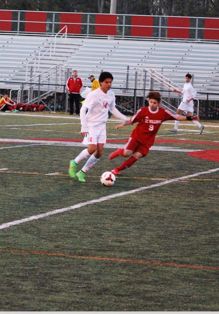 Junior Rudy Flores competes in a soccer match against the T.C. Williams Titans on March 27.