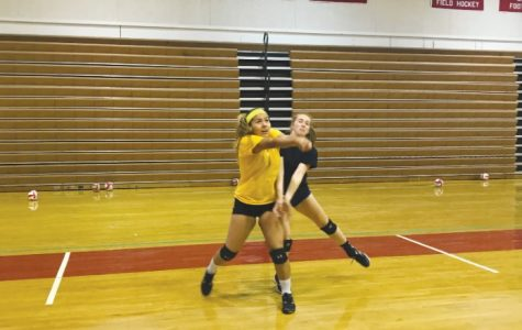 Senior Valeria Salinas (Left) goes for a bump during practice.