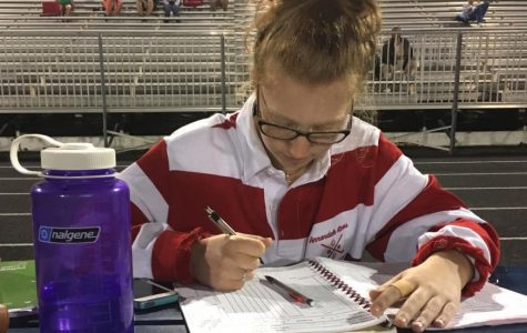 Senior field hockey manager Lydia Peters book keeps during a game against the Lee Lancers on Sept. 19.