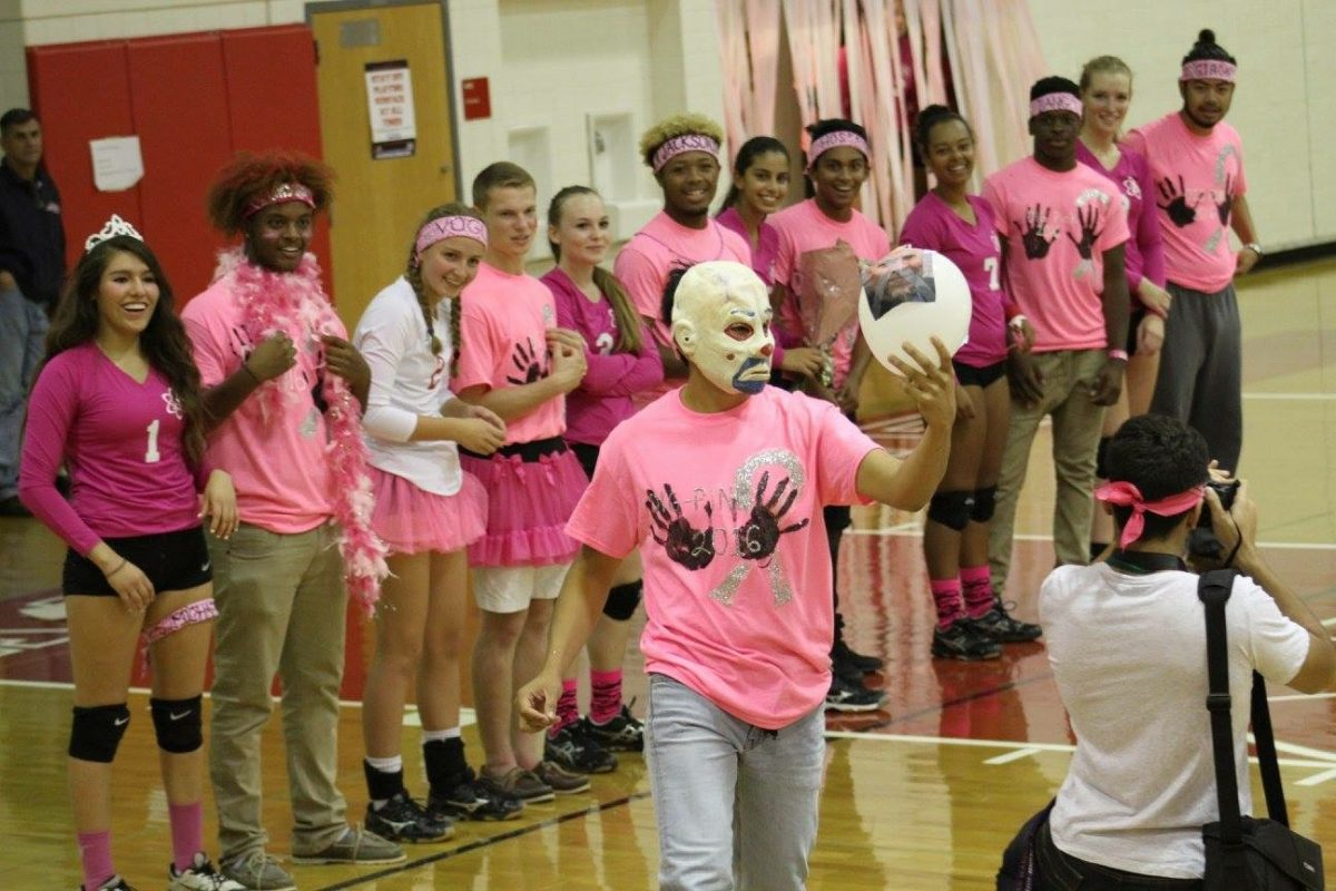 The+Atoms+volleyball+team+takes+part+in+their+dig+pink+tradition+to+raise+awareness+about+breast+cancer+before+a+game+last+season.+