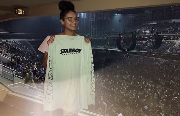 +Senior+Kendall+McCleary+holding+her+Starboy+concert+merchandise.