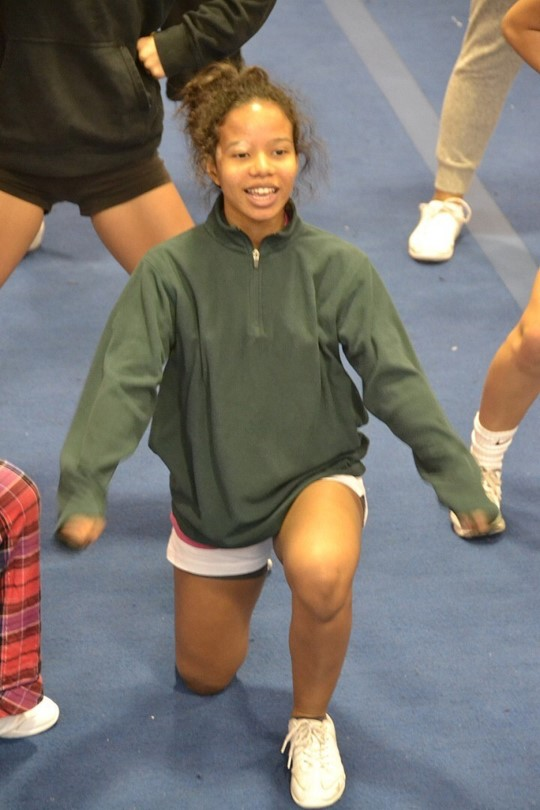 Senior+Alichia+House+puts+some+pep+in+her+step+as+she+bends+down+to+perform+the+next+step+of+her+cheer+routine.+%22I+like+doing+stunts+because+they+are+difficult%2C+but+also+the+most+fun+because+it%27s+very+satisfying+when+I+hit+a+stunt+cleanly%2C%22+House+said.